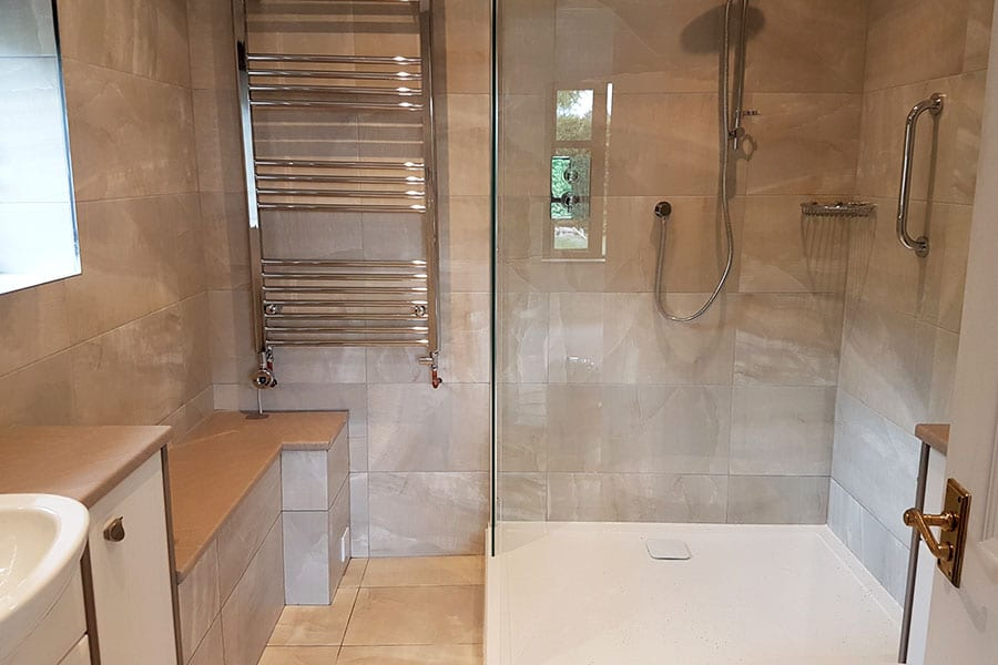 Walk in shower and fitted furniture in Dorset bathroom
