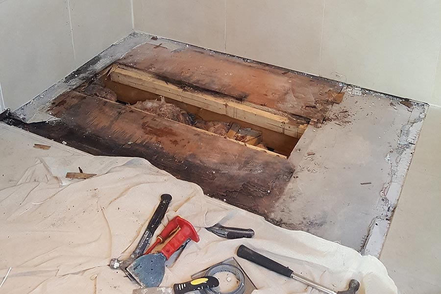 Damage to floor joists caused by a leaking shower in a wetroom