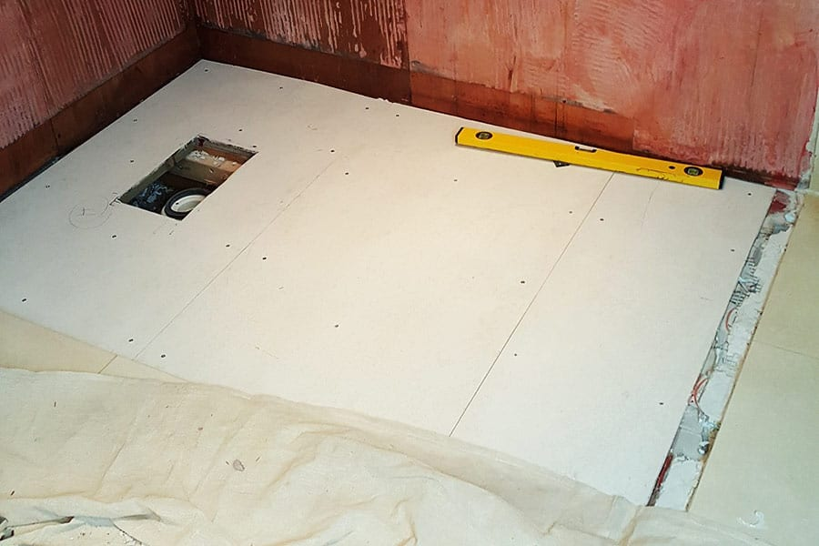 Repaired bathroom floor following a leaking shower