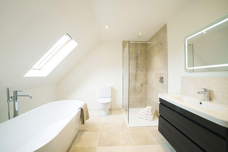 Luxury modern bathroom with dark wood vanity unit and walkin shower enclosure