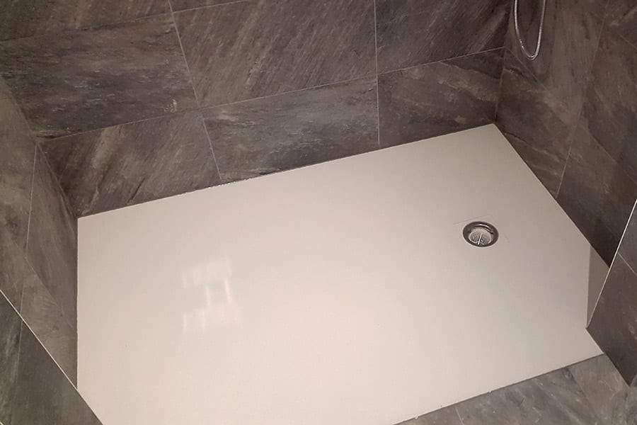 A custom made shower tray with cut away corners produced for Conceptual Homes in Poole Dorset by Room H2o