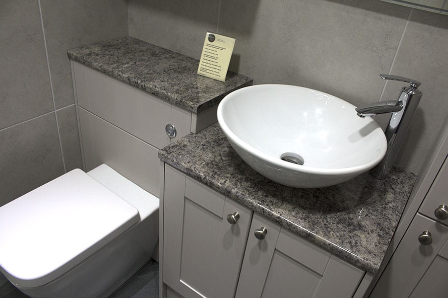 Design Clypso fitted bathroom furniture in bracken graphite ripple colour and shaker style
