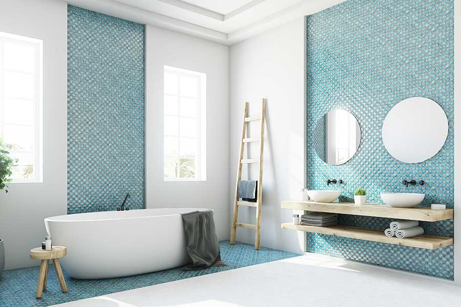 Aqua blue mosaic wall tiles in large bright bathroom