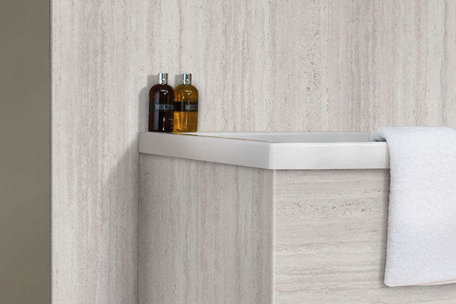 Seamless bathroom wall panels in travertine effect from the Nuance collection by Bushboard