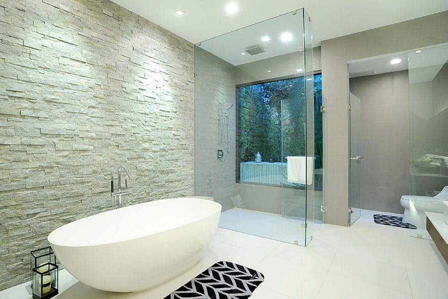 Luxury freestanding bathtub with walk in shower