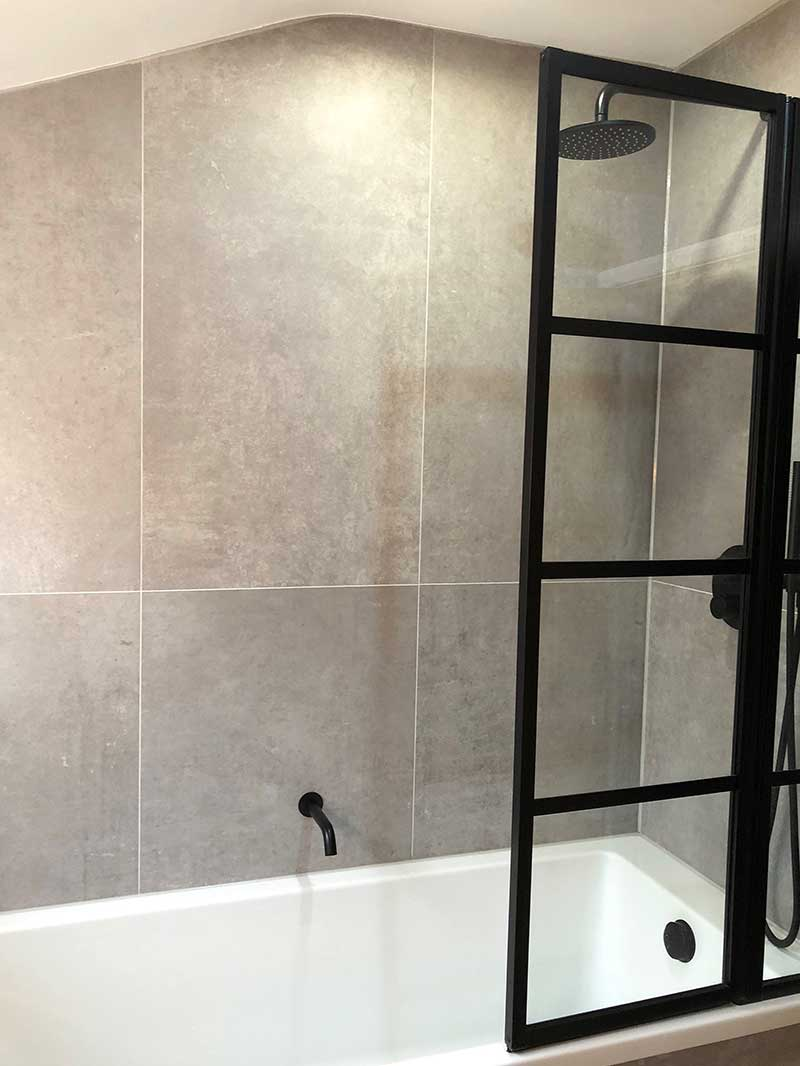 Drench Art Deco style made to measure bath screen with black frame