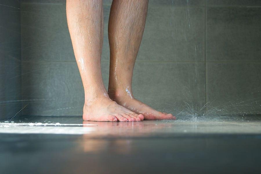 Slip resistant black floor tiles in a wet room shower