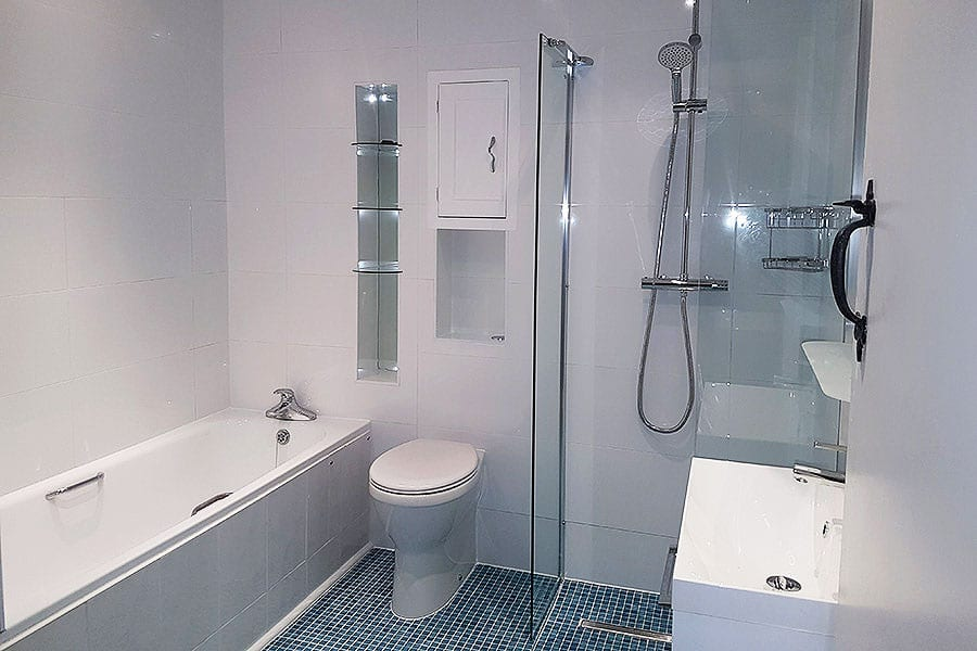 A bathroom created by Room H2o for a disabled customer in Dorset by Room H2o