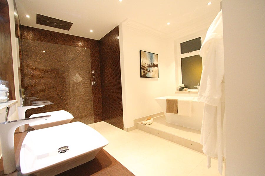 Effective bathroom lighting highlights design features and washing areas