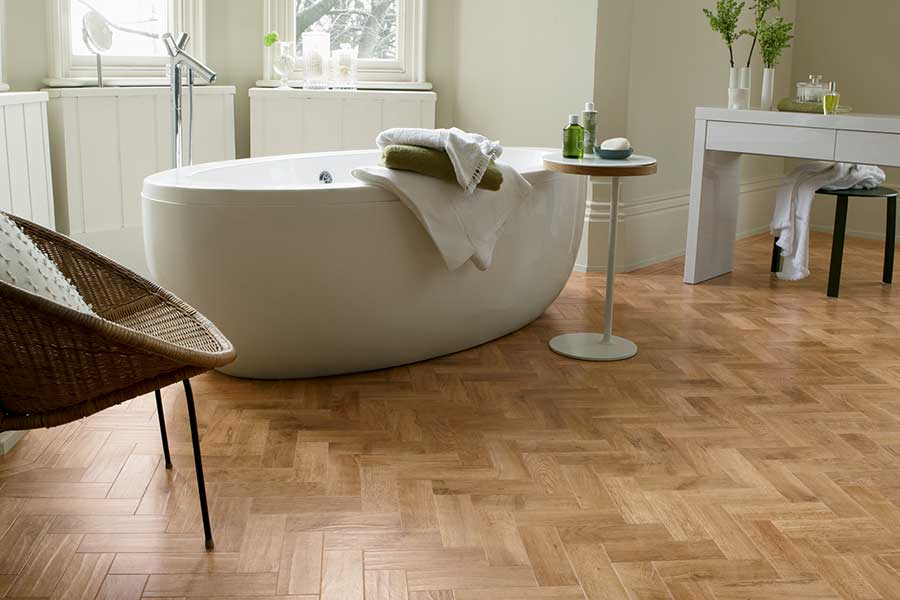 Blonde oak effect vinyl flooring planks by Karndean