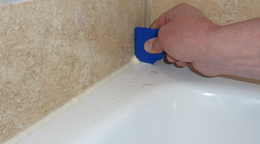 A Fugi silicone sealant finishing tool creates a neat bead of silicon sealant around the perimeter of the shower tray