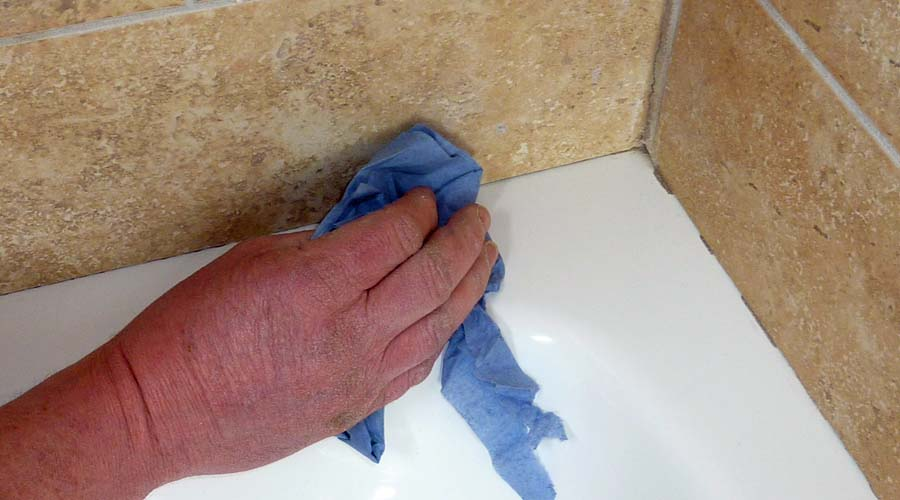 Thoroughly clean the shower tray and tiles to ensure the surface is free of dirt and grease before applying silicone sealant