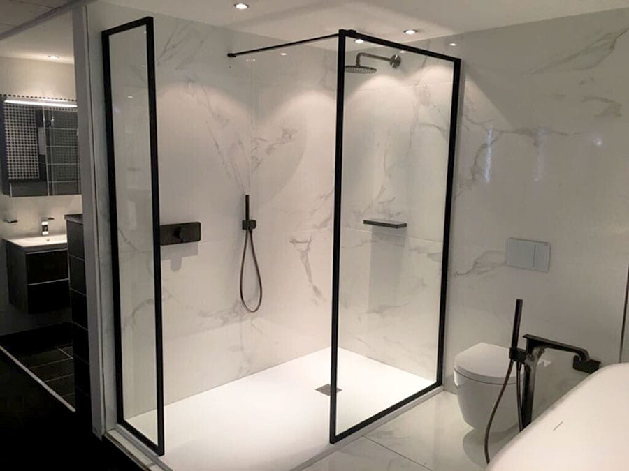 A black Drench walkin shower enclosure with white Fiora shower tray