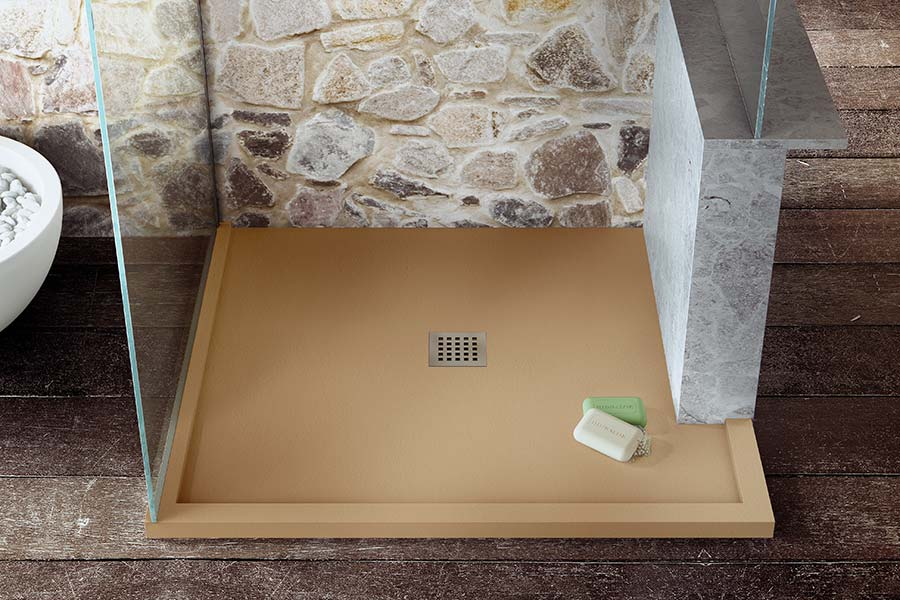 A made to measure slim shower tray in rich sand colour with cut away side by Room H2o