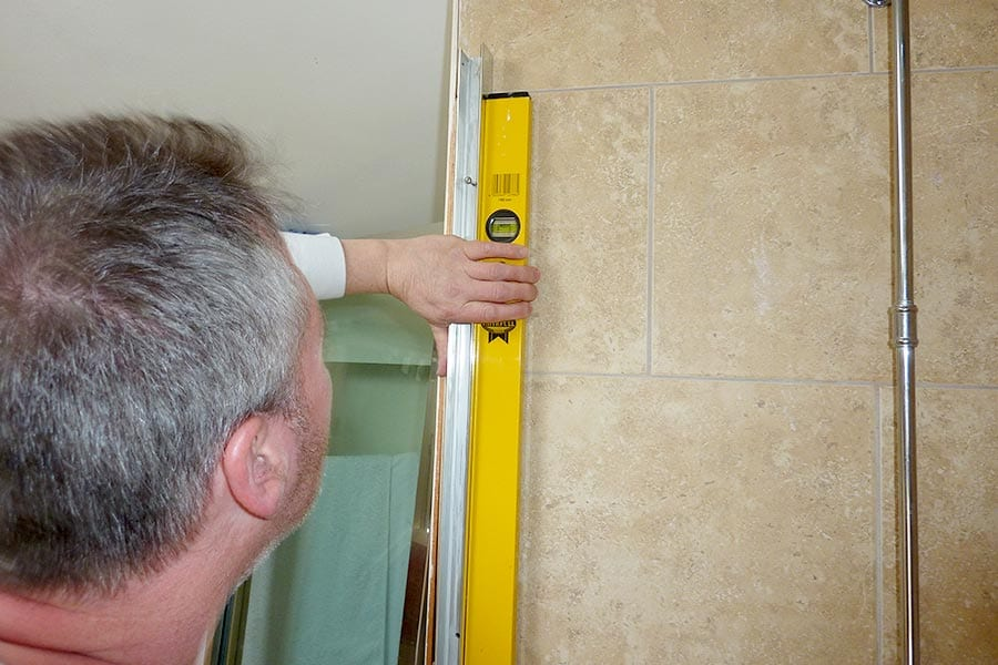 Room H2o shower technician measure for a bespoke shower enclosure