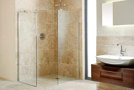 Large luxury Impey wetroom with large frameless shower enclosure and stone tiles