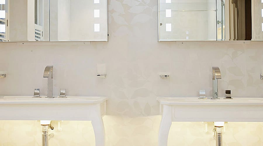 Elegant twin wash basins with led under lighting and white Porcel-Thin Paris tiles