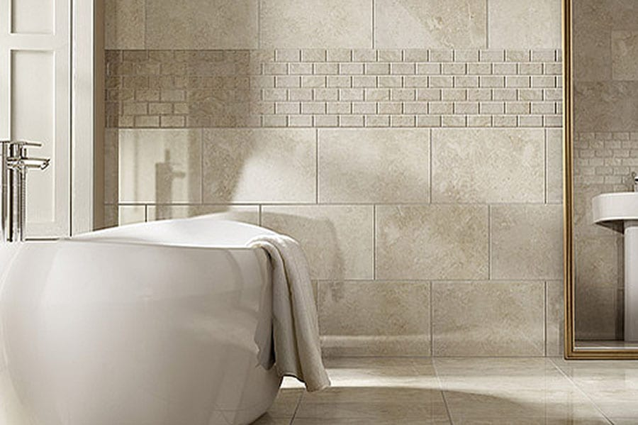 Luxury bathroom featuring imperial light beige marble wall and floor tiles with a freestanding bath