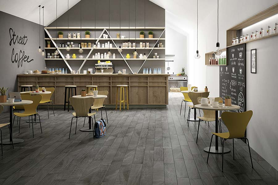 Burlington graphite stone effect floor tiles create a dramatic effect in this trendy cafe