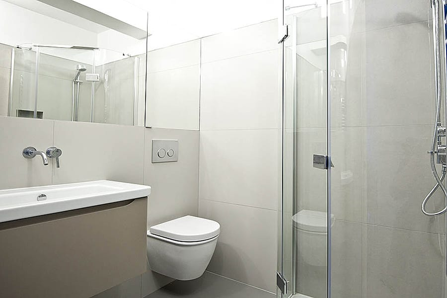 A modern bathroom featuring off white Porcel-Thin large format porcelain wall and floor tiles