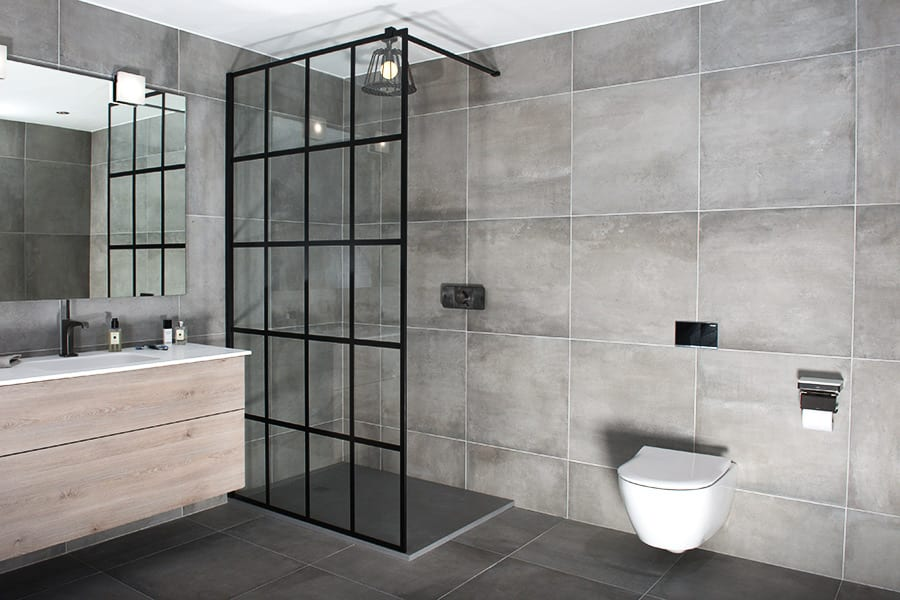 Custom made Frame grid style black shower screen by Drench with matching black vintage lamp shower head