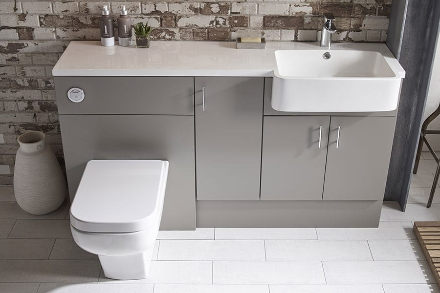 Modern grey Muse fitted bathroom furniture with integral worktop and basin by Roper Rhodes