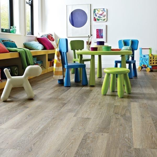 Karndean Knight Tile Limewashed Oak vinyl plank flooring in a children's play room