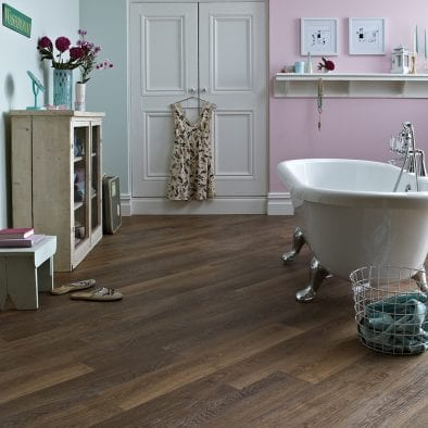 Karndean Knight Tile pale mid limed oak effect vinyl plank flooring in a period bathroom