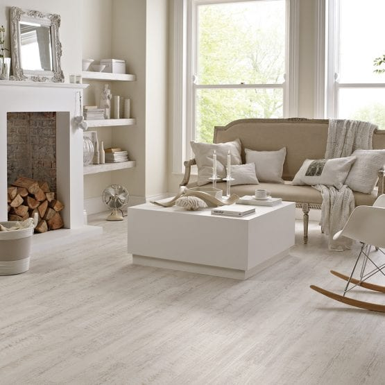 Lounge floor covered with white painted oak effect vinyl planks from Karndean