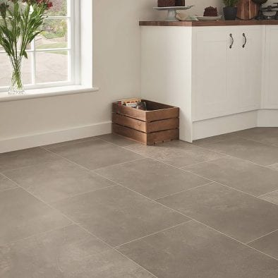 Karndean Fumo stone effect grey vinyl floor tiles in a modern kitchen