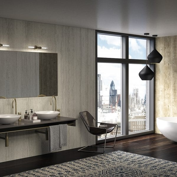 Luxury bathroom featuring BB Nuance Platinum Travertine stone effect bathroom wall cladding with a riven finish