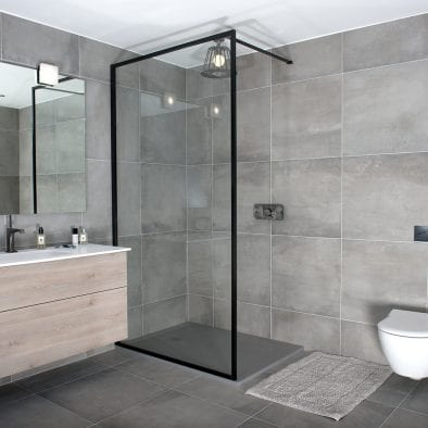 A black slim framed BORDER shower screen by Drench