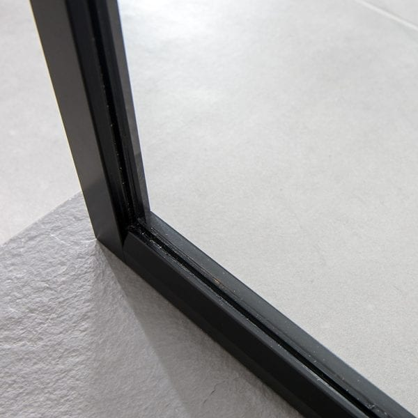 The slim frame detail of a Drench 8mm glass black shower screen