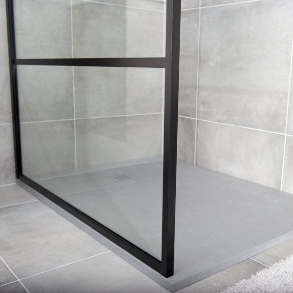 The slim frame detail of a Drench 8mm glass art deco style black shower screen
