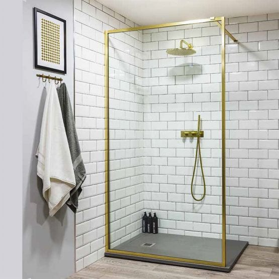 Drench Border minimalist shower screen with brushed brass metal frame detail