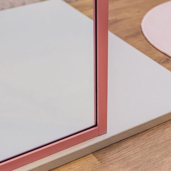 Drench Border minimalist shower screen with matt pink frame detail
