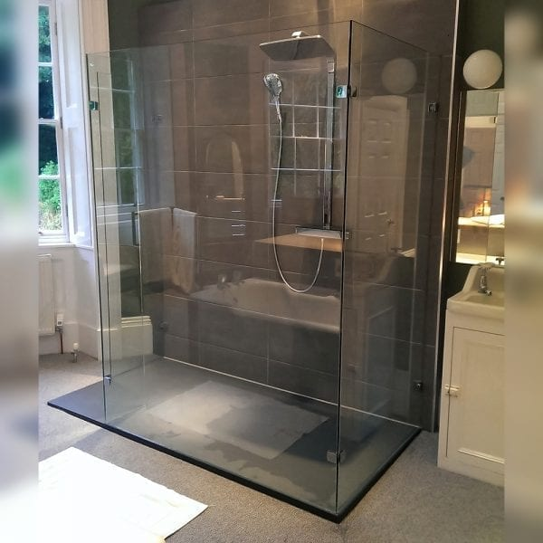 Large bespoke glass walk-in shower screen with 3 sides on a large flat tray by Room H2o
