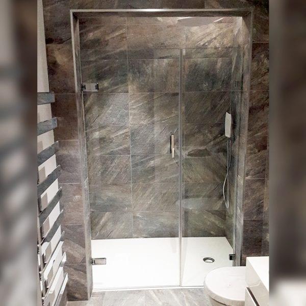 Bespoke framless wall hinged shower door with inline panel