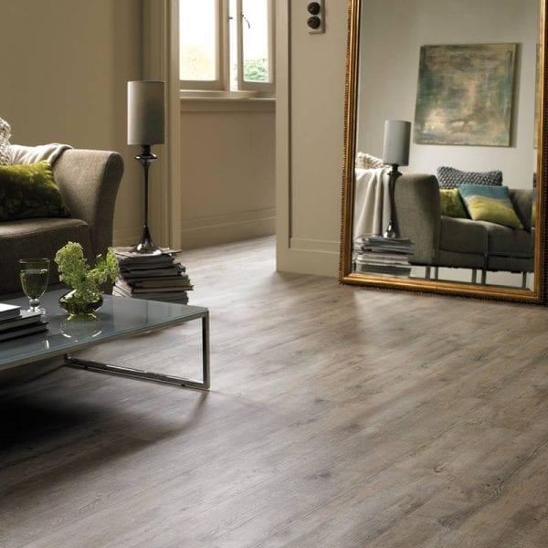 Karndean Van Gogh distressed oak vinyl plank flooring in a cosy lounge