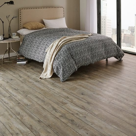 Karndean distressed Oak vinyl plank flooring in a bedroom setting