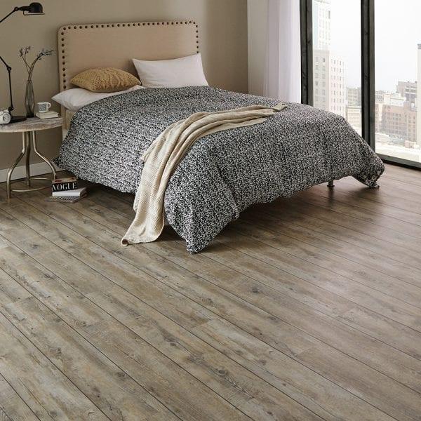 Karndean distressed Oak vinyl plank flooring in a bedroom setting