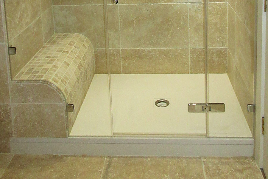 White Fiora made to measure shower tray and tiled shower seat by Room H2o
