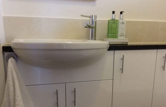 Compact vanity unit and semi recessed basin