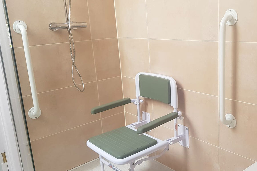 Padded fold down shower seat installed by Room H2o as part of a easy access wetroom in Wareham
