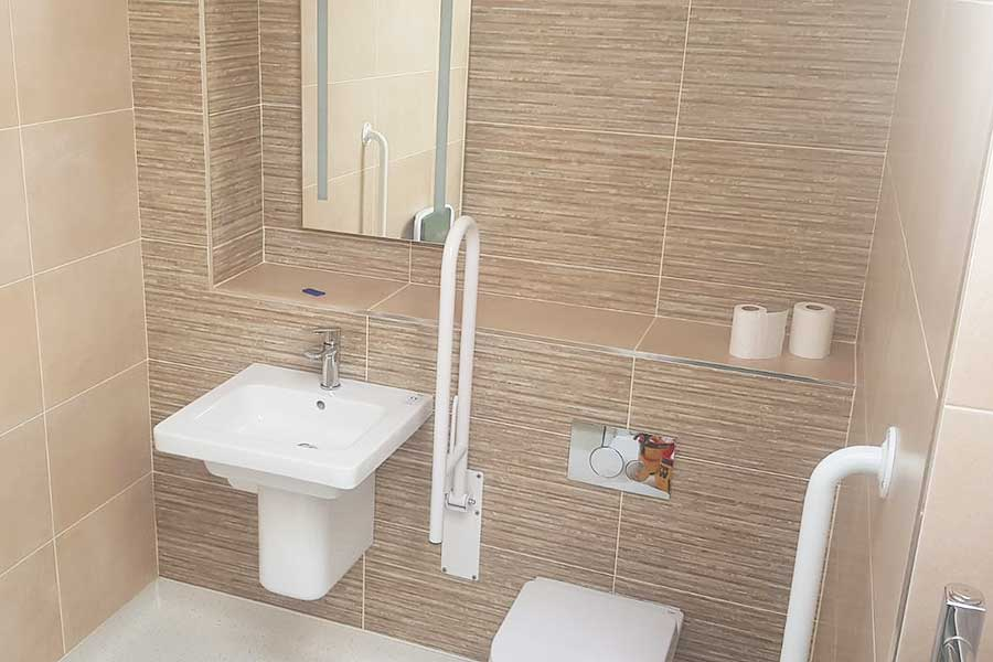 Easy access bathroom and wetroom with grab rails created by Room H2o for a customer in Wareham