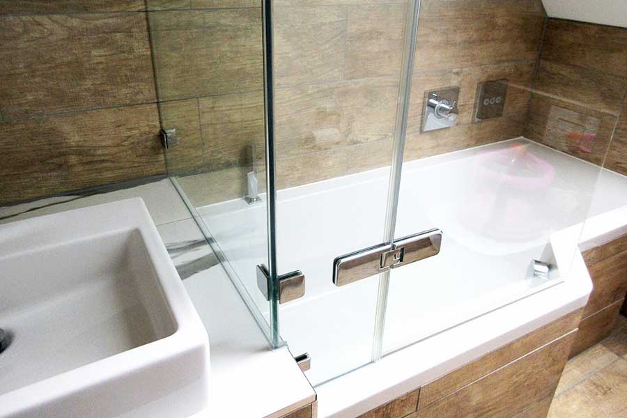 Frameless shower enclosures can be shaped to fit bath tubs