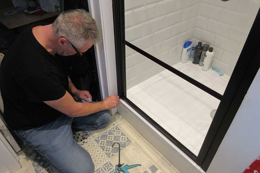 Room H2o technician installing a made to measure shower enclosure