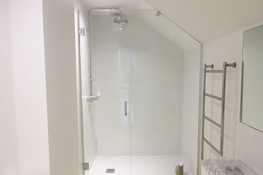 Semi-frameless angled made to measure shower enclosure in a loft conversion