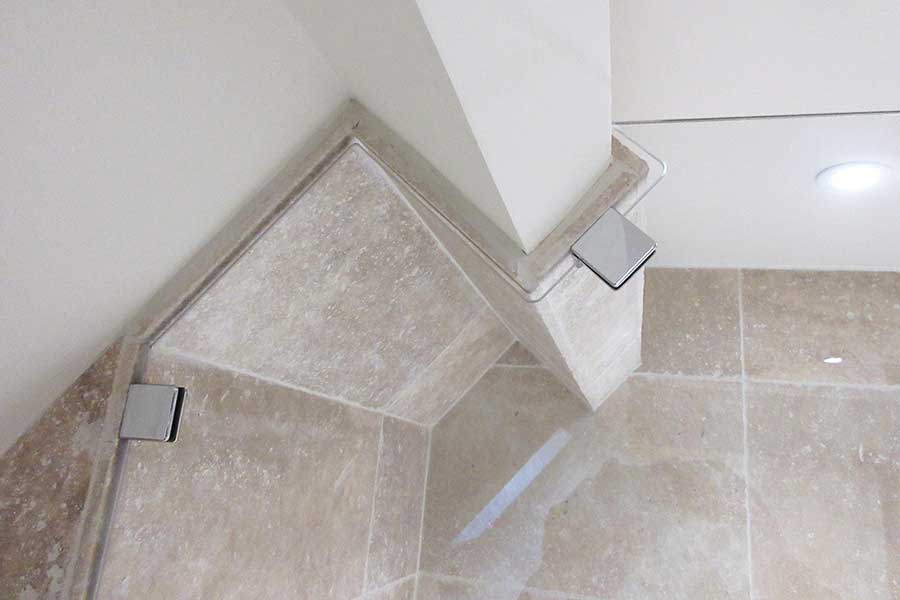 frameless glass shower screen shaped around a ceiling bean by Room H2o
